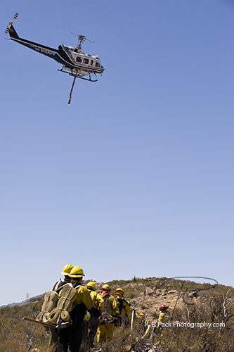 Helicopter crew with copter 12 above heading for a drop in support